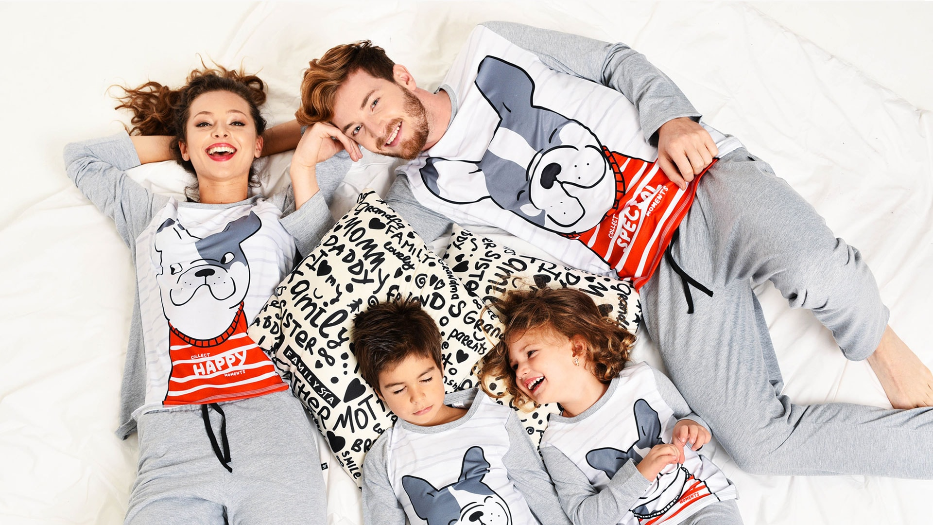 family with matching pajamas on the bed