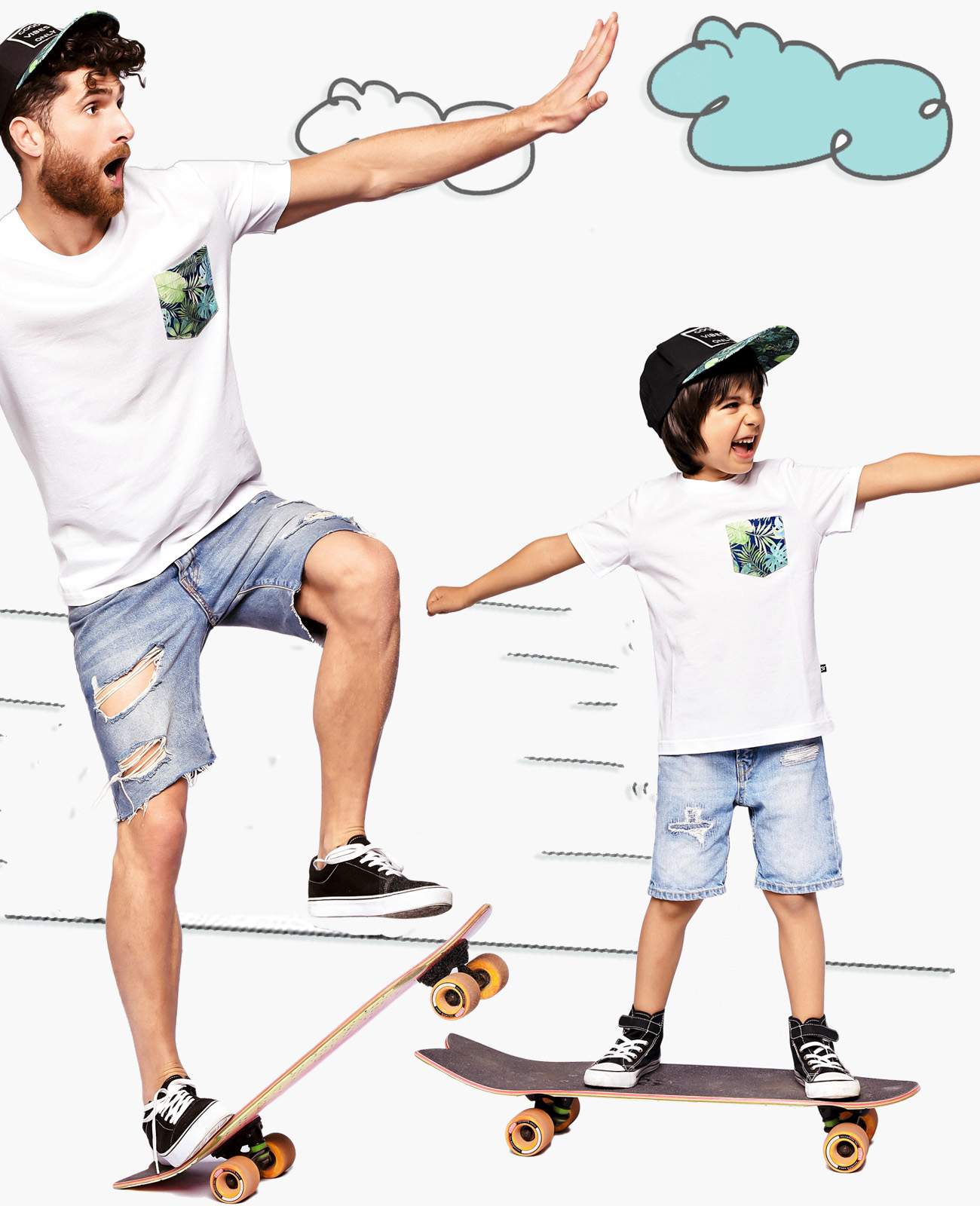 Dad and son having fun on skateboards in matching tees