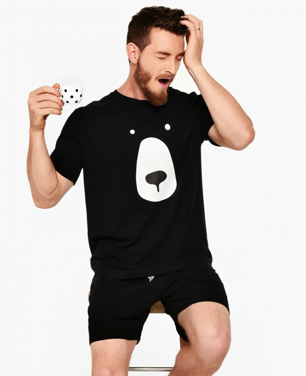 man with a cup of coffee in bear pajama