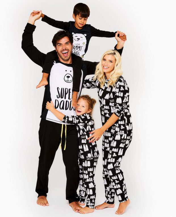 family with 2 kids in matching pajamas