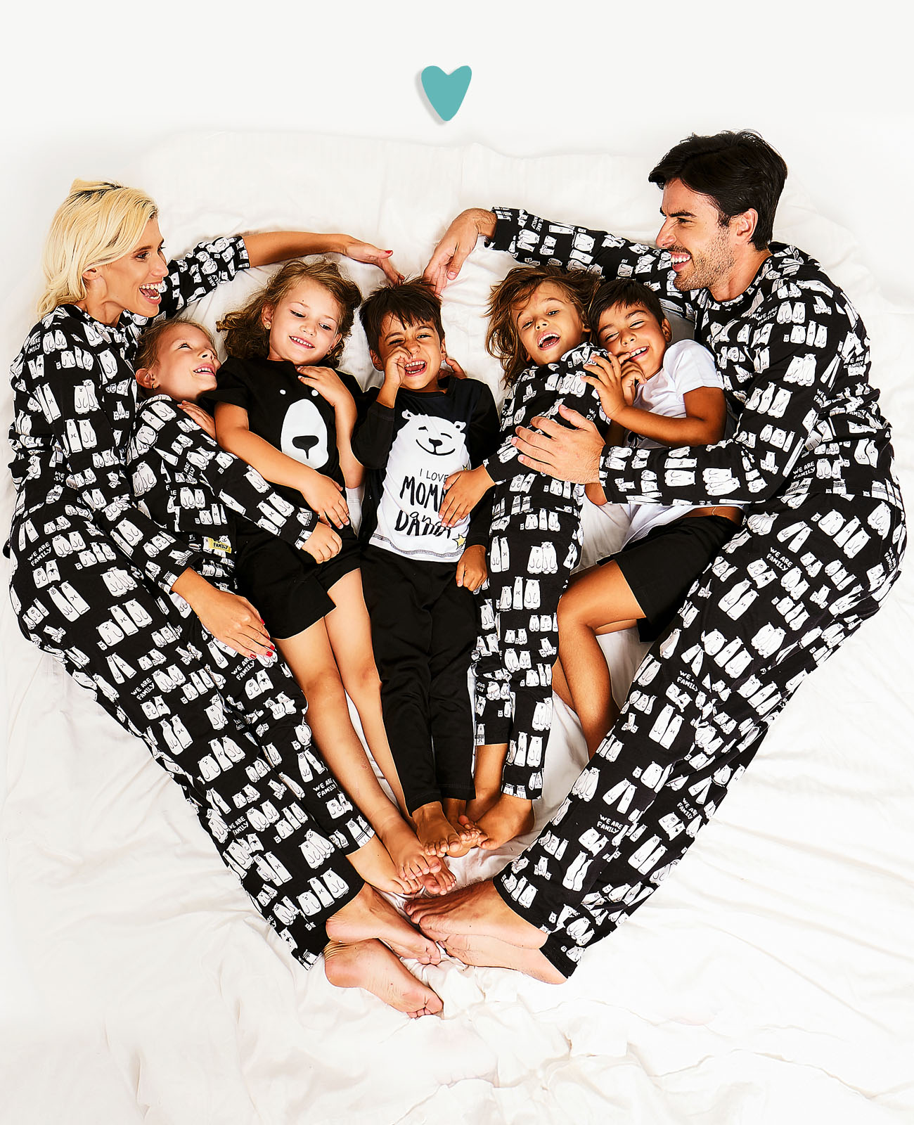 Family in bed with matching swimsuits